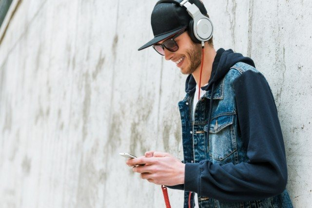 Man listening to music and smiling