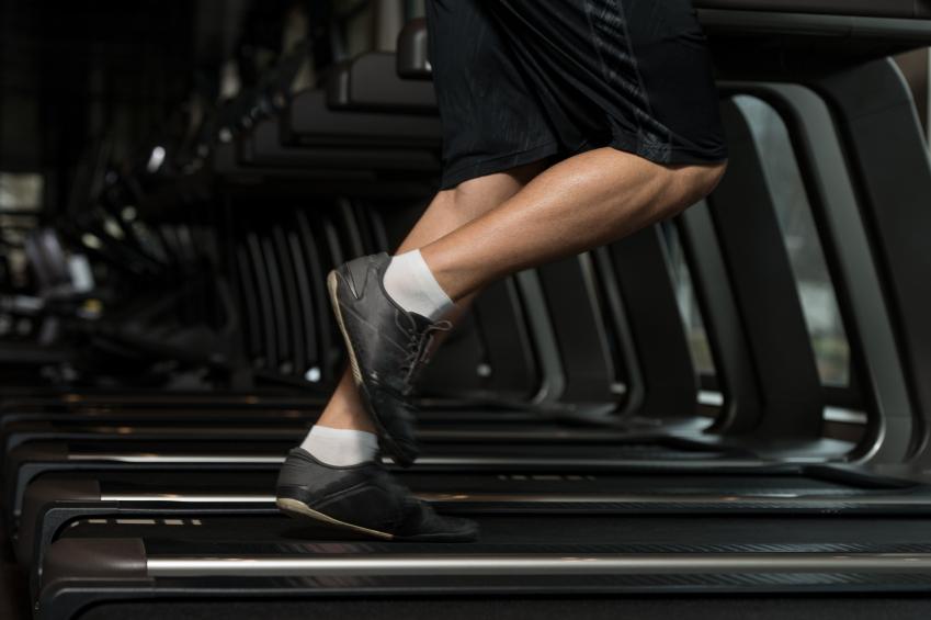Man running hard on a treadmill