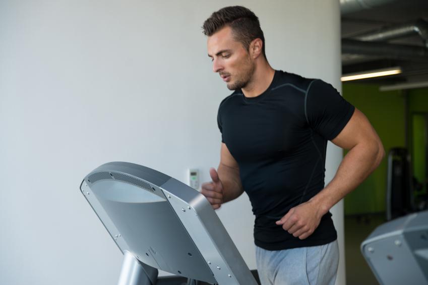 Tired man running on a treadmill