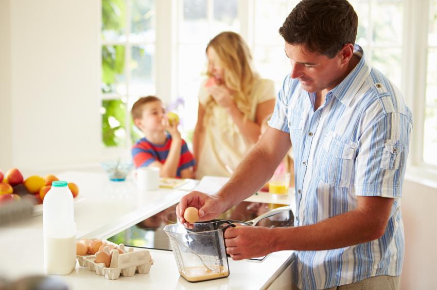 man making breakfast