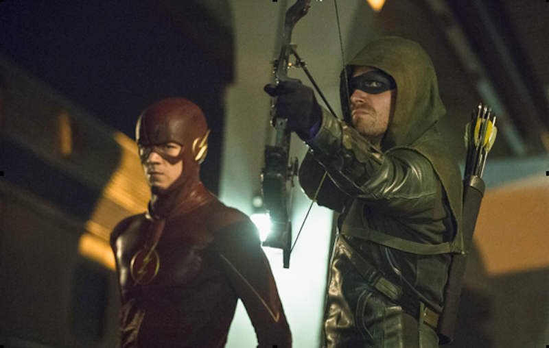 Grant Gustin and Stephen Amell as The Flash and Arrow