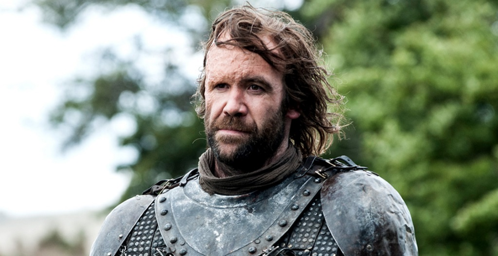 The Hound stands in his armor.