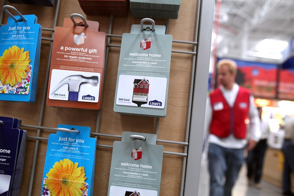 Holiday gift cards displayed on a rack.