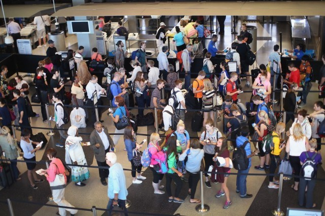 busy airport line at security
