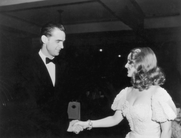 Howard Hughes shakes hands with American actress Bette Davis