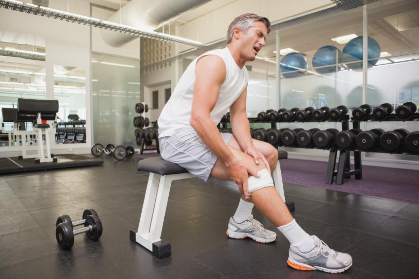 A man nursing an injury at the gym