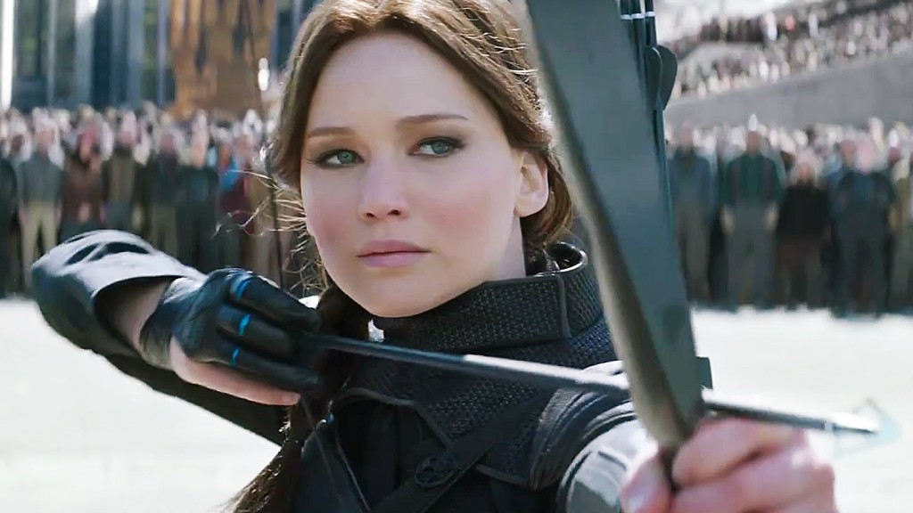 This is a closeup of Katniss aiming her bow and arrow in The Hunger Games: Mockingjay.