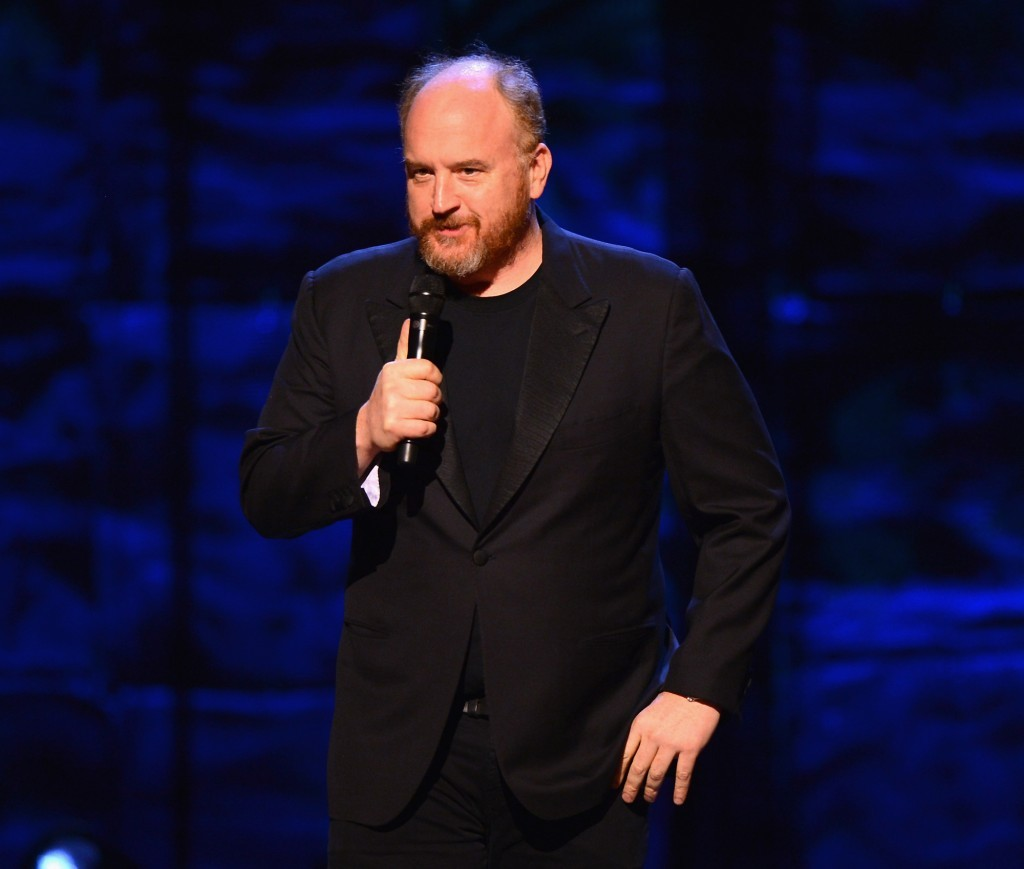Louis CK performs on stage