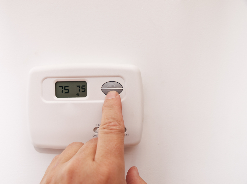 changing the temperature on a house thermostat