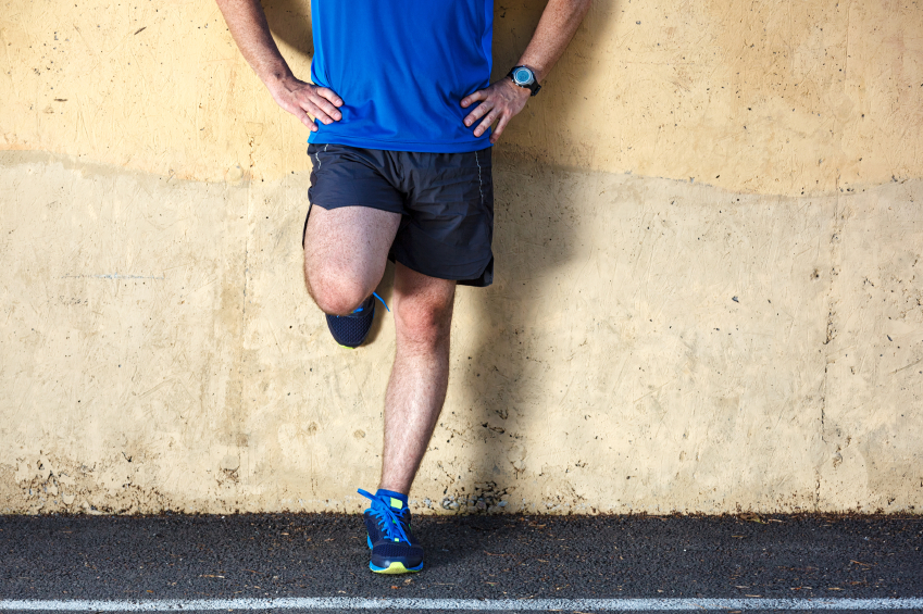 runner leaning against a wall