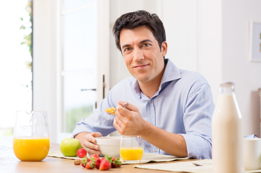 A man eats a healthy breakfast.