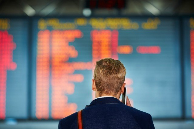 Traveler looking at the departures board at the airport
