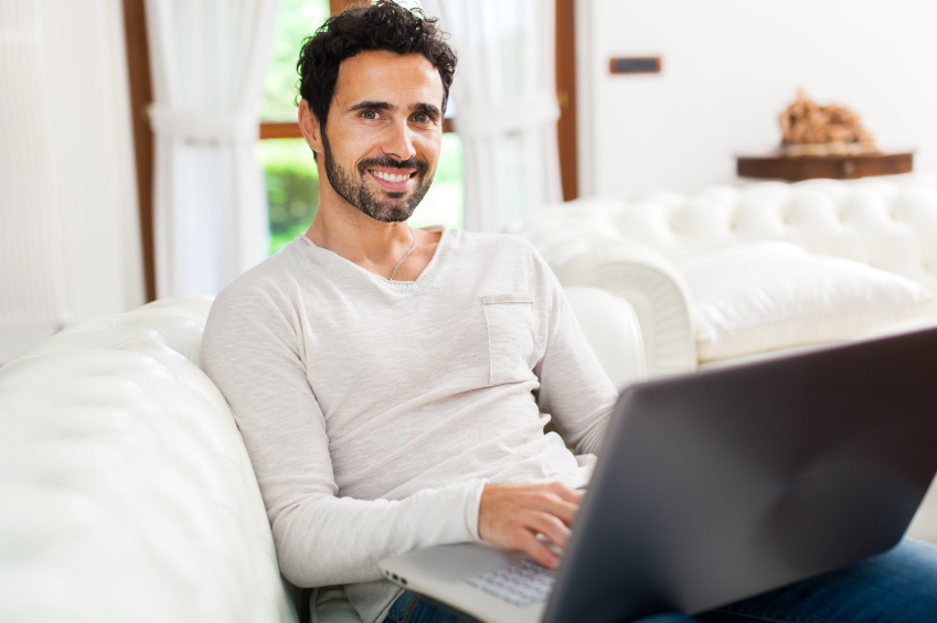 man relaxing with his laptop