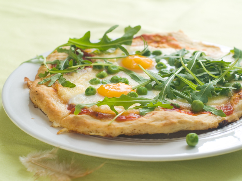 Pizza with Egg, Roasted Red Peppers, Olives, and Arugula