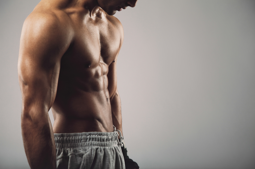 a clean shaven man posing, six pack abs