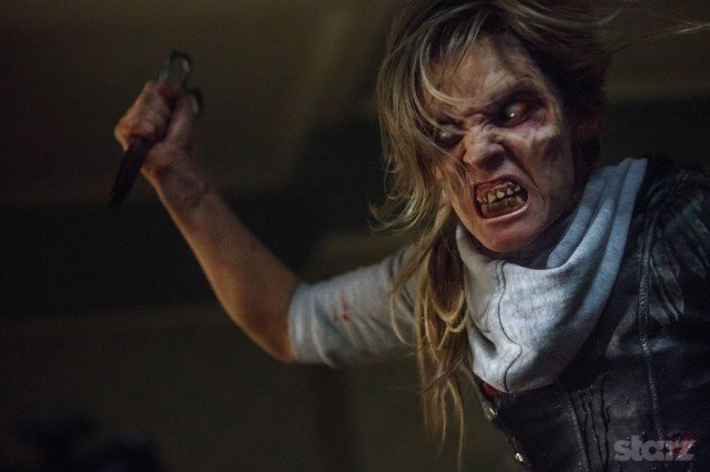 A zombie woman holding a pair of scissors in 'Ash vs. Evil Dead'.