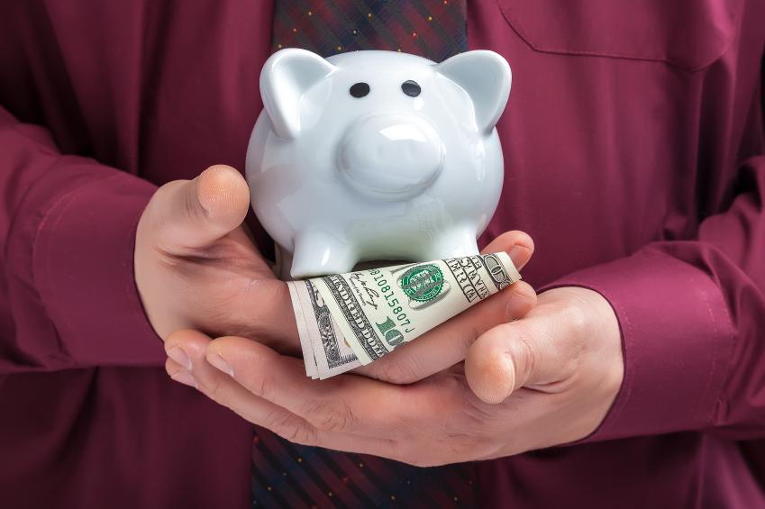man holding money and piggy bank