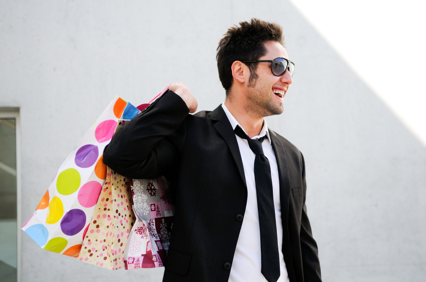 a man with shopping bags on a shopping spree