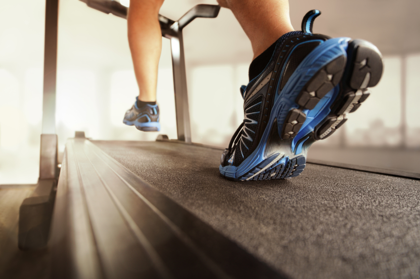 close up of a person walking on a treadmill