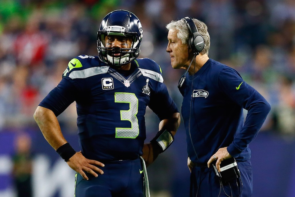 GLENDALE, AZ - FEBRUARY 01: Head coach Pete Carroll of the Seattle Seahawks talks to Russell Wilson #3 of the Seattle Seahawks in the second quarter during Super Bowl XLIX at University of Phoenix Stadium on February 1, 2015 in Glendale, Arizona. (Photo by Kevin C. Cox/Getty Images)