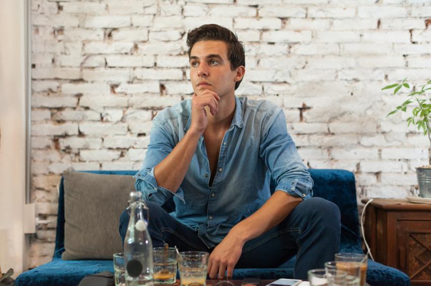 man drinking at a lounge