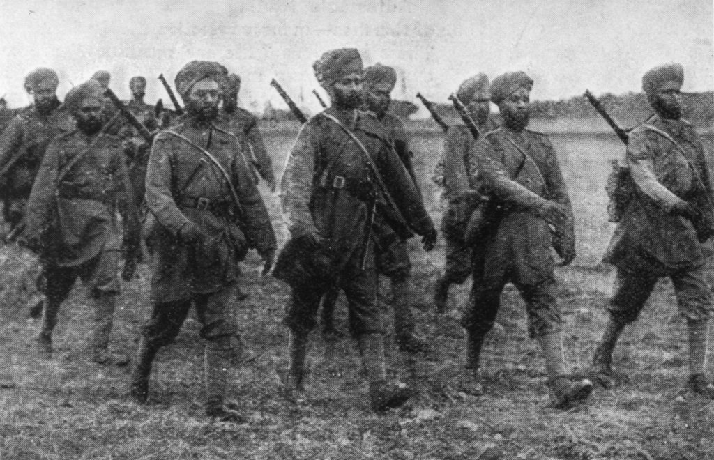 Black and white photo of Sikh soldiers marching in World War I