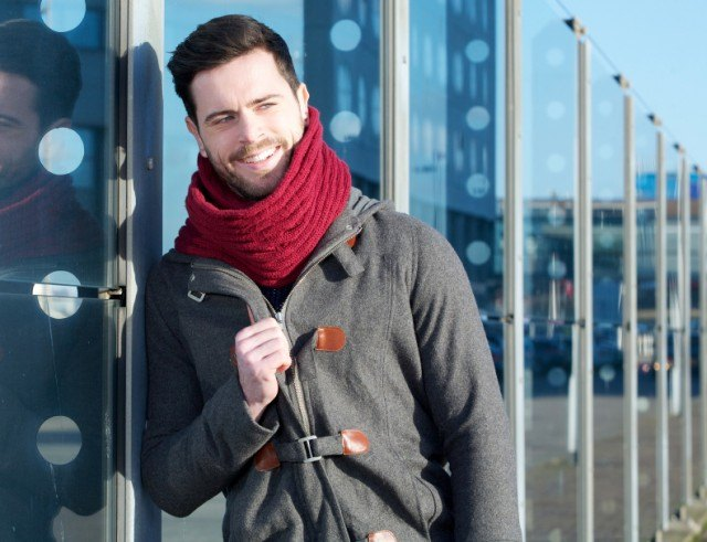 man wearing a red scarf with his outfit