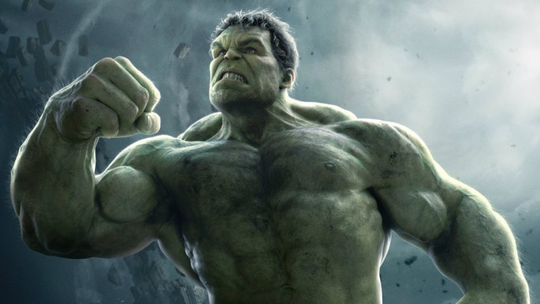 The Hulk holds up a fist while looking angry