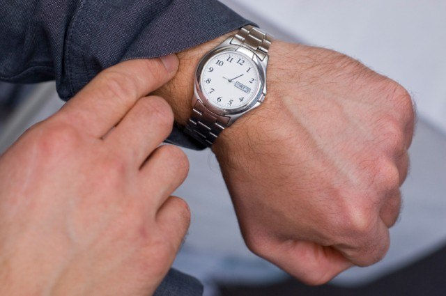 A man checking the time