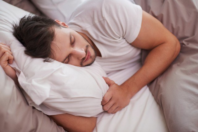 Man tired in bed