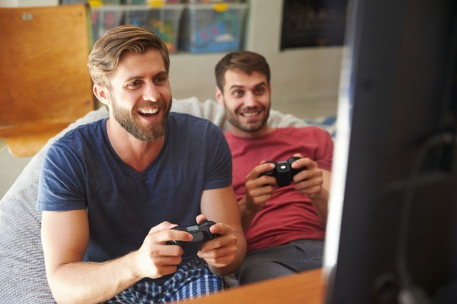 Two men gaming and having fun