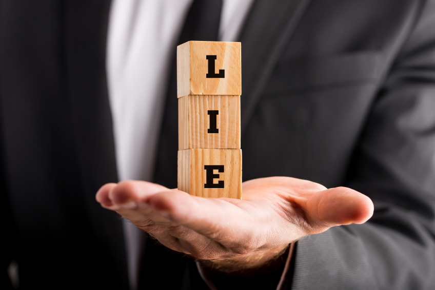 lie spelled out with wooden blocks