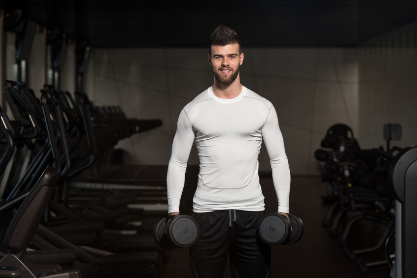 Man doing exercises to get bigger arm muscles