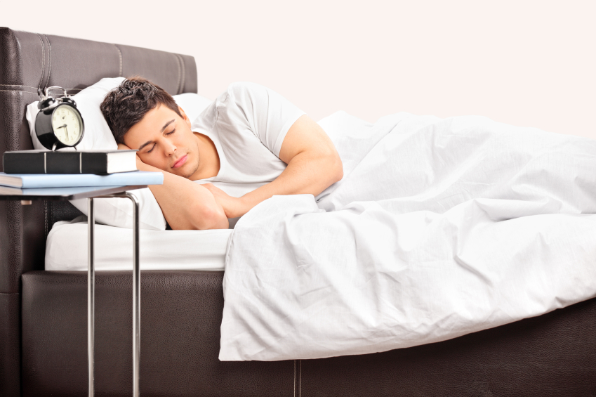 Man sleeping next to alarm clock