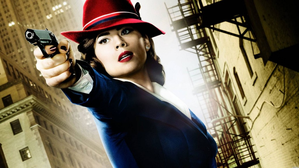 Hayley Atwell in a blue suit and red hat pointing a gun off-camera in Agent Carter poster art