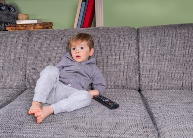 Child watching TV on the couch