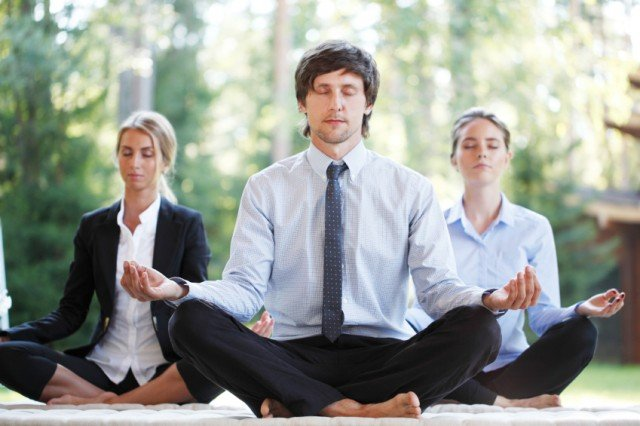 Business professionals doing yoga