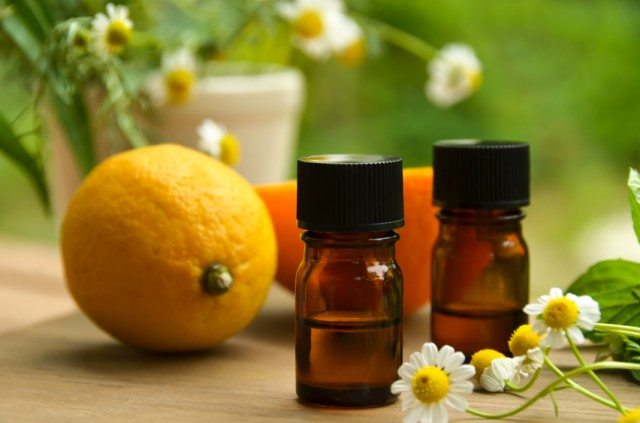 aromatherapy oils with flowers and orange