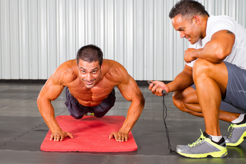 two men doing push ups