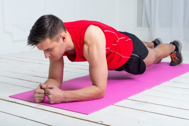 man holding a plank exercise