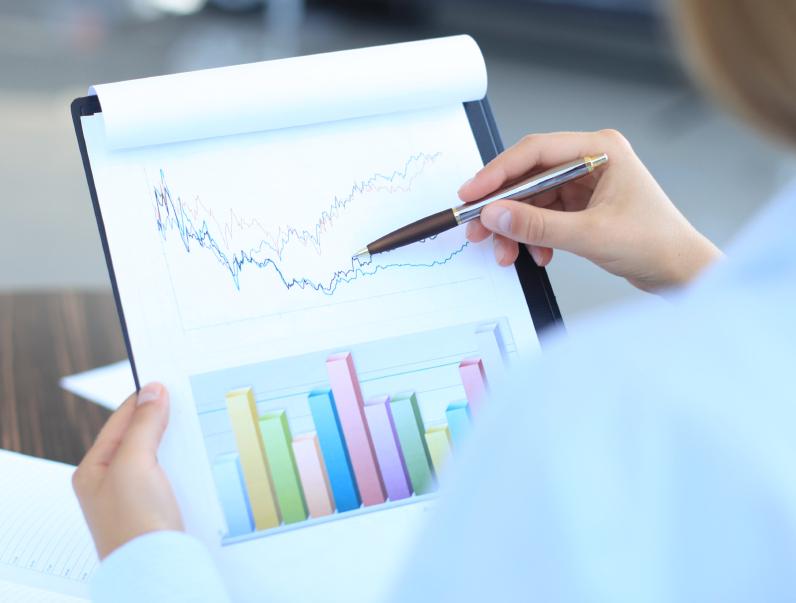 businessman holding charts