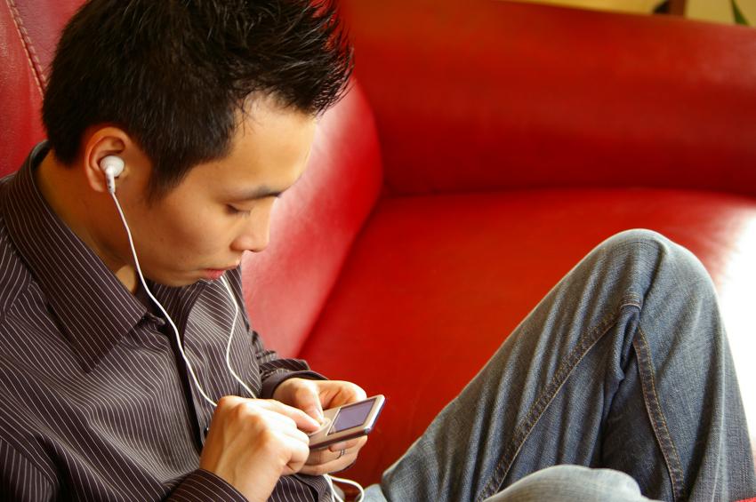 man listening to music, ear buds, headphones