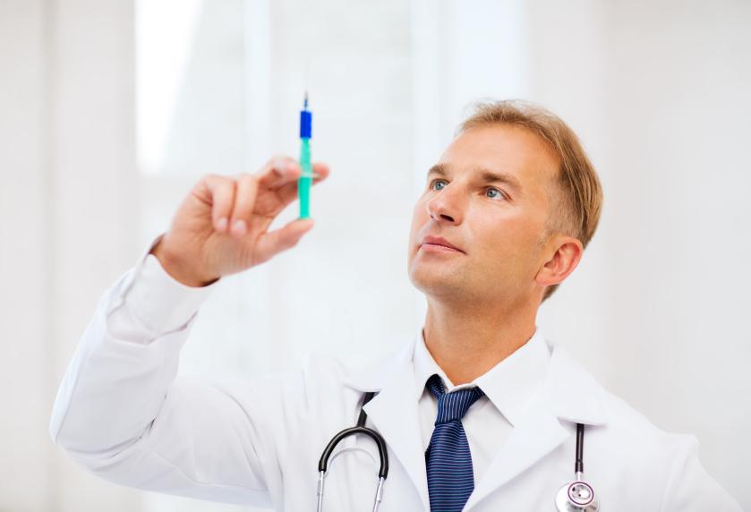 A dermatologist prepares a syringe