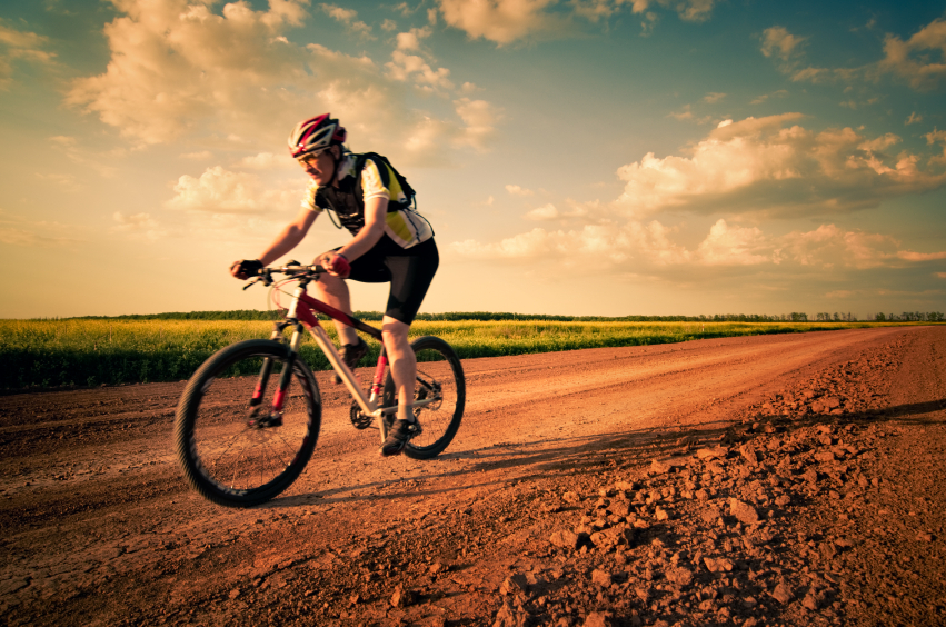 Man biking on a dirt road