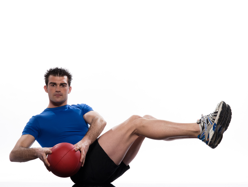 performing an ab exercise with a medicine ball