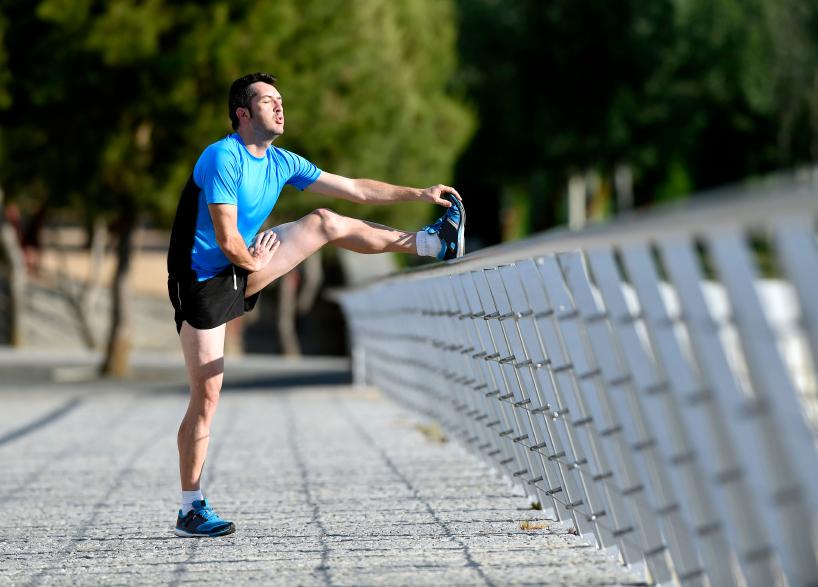 A man stretches before a run