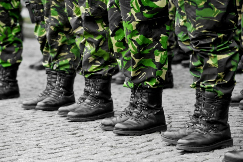 Military service members stand in a line