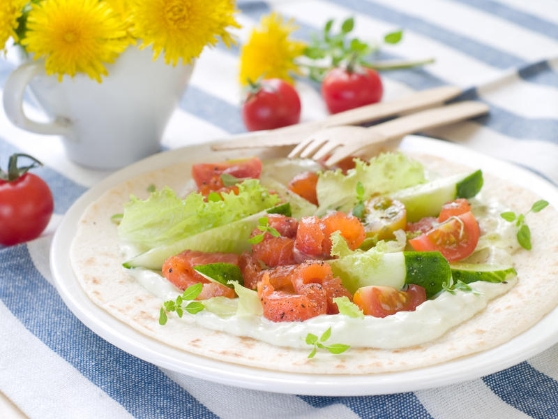 Pita with salmon, tomato and sauce is on of several tasty sandwiches