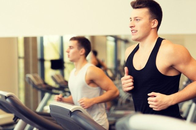Two men running on treadmill doing HIIT workout