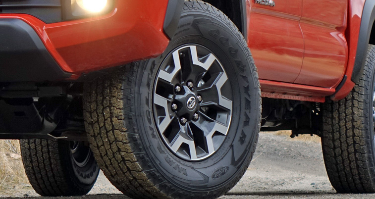 Alloy wheel and Goodyear Wrangler tire on a 2016 Toyota Tacoma TRD Pro.